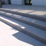 Installation of antislip fine porcelain tile with a steel profile in the corner to cover the stepsPosa del gres porcellanato antiscivolo con profilo in acciaio per rivestire i gradini