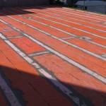 Sealing of the sheath using polyethylene strips and cement adhesiveSigillatura della guaina per mezzo di bandelle di polietilene e collante cementizio
