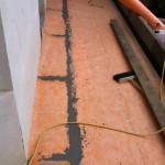 Laying of waterproofing system under porphyryPosa del sistema di impermeabilizzazione sotto il porfido