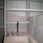 Particolar view about Stella taps and Grigio Tunisi vains and washbasinVista particolare della rubinetteria Stella con vani e lavabo in Grigio Tunisi